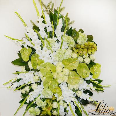 Funeral wreath with gladiol, anthurium, cymbidium, hydrangea and rose
